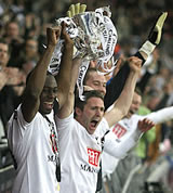 Ledley King and Robbie Keane lift up the Carling Cup after our magnificent win over Chelsea on February 24th, 2008