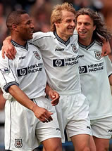 The smiles tell it all! Les Ferdinand, Jurgen Klinsmann and David Ginola celebrate a great win, and survival for Spurs!